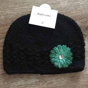 8fa6c03ca08 Black Crocheted baby hat with green flower pin